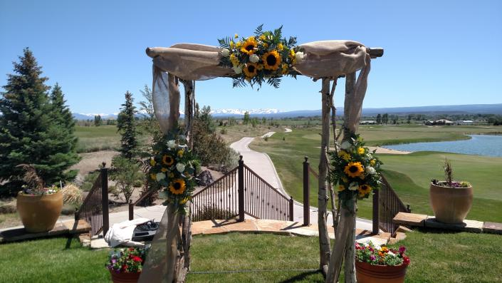 Aspen arch with beatiful floral swag