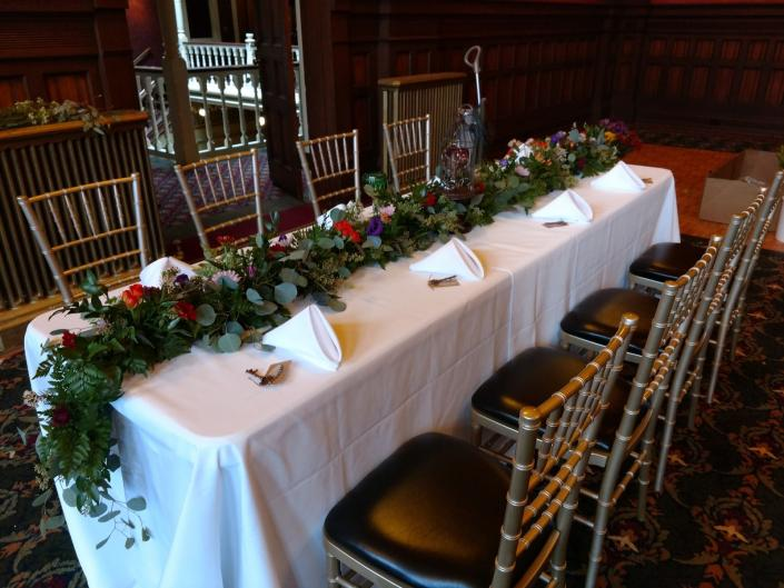 [Image: Elegant table garland set up in the historical Beaumont in Ouray Colorado ]
